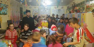 Un preot din Alba ajuta peste 200 de copii si varstnici din familii nevoiase: